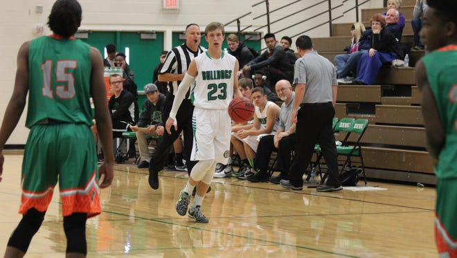 Zach Barnum surveys the defense while bringing the ball up the floor during the recent Bulldog Invitational.