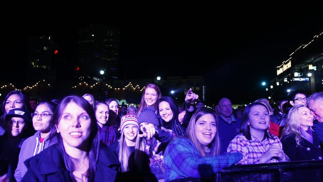 The crowd enjoys the New Year's Eve Block Party in  Tempe on Thursday, Dec. 31, 2015.