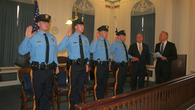 Anthony J. Jones Jr. (far left), a New Brunswick police officer, has been charged with assault along with four other men stemming from an alleged fight that occurred at a bar.