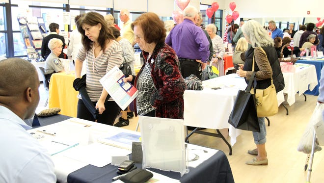 People check out vendor tables of health information and giveaways during the 2012 Indio Senior Center Health Fair on Tuesday, February 7, 2012.