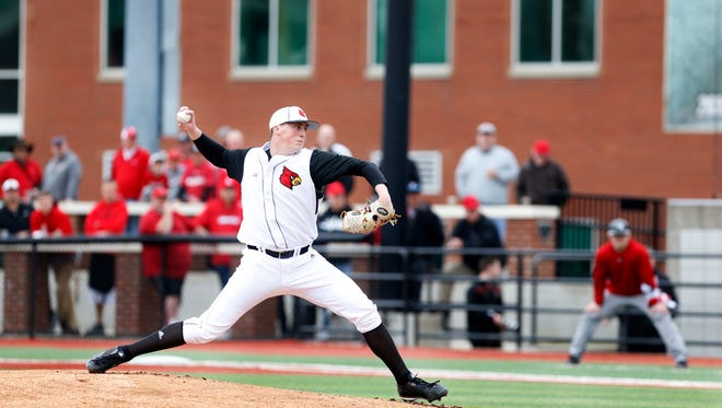 Louisville's Kyle Funkhouser hurls the pitch to the plate against SIU-Edwardsville.Feb. 19, 2016