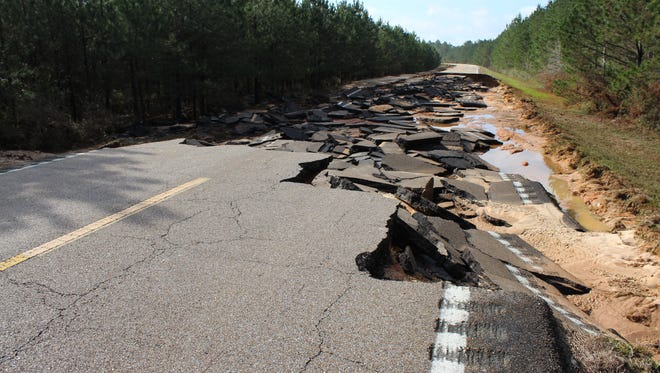 A stretch of Mississippi 589 in Lamar County was destroyed by floodwaters.