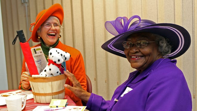 """Clarksville women gathered at The Leaf-Chronicle Saturday to celebrate a """"girls day"""" with friends who are always by their side. Barbara Beeman, left, and Delinia Storr tied for the most votes in the best hat contest."""