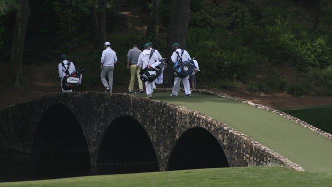 Crossing Hogan Bridge at Augusta National Golf Club
