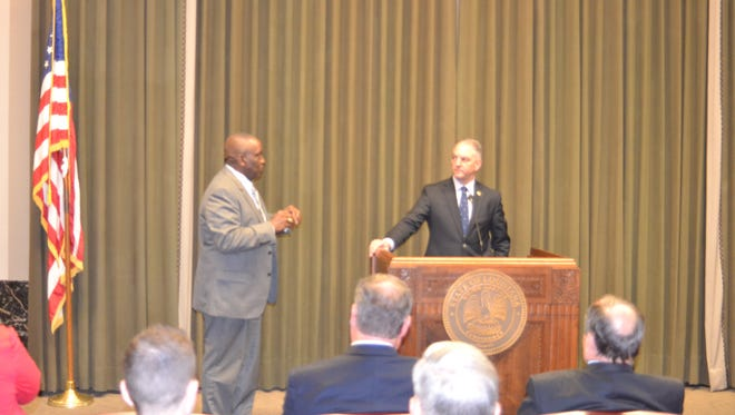 Gov. John Bel Edwards (right) takes a question from Pineville Mayor Clarence Fields (left) during Central Louisiana Day at the Legislature Wednesday.