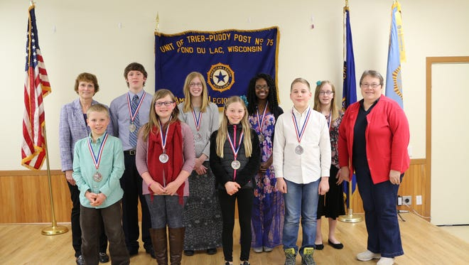 Pictured are, back row, from left: Fond du Lac American Legion Auxiliary Post 75 Americanism Chairperson Linda Phillips, Drew Jorgenson, Madelyn Dyk, Christina Beaubrun, Lydia Dyk; front row, from left: Weston Huempfner, Teva McQuitty, Ava Huempfner, Caleb LaBatte, Fond du Lac American Legion Auxiliary Post 75 President Sandi Smet.