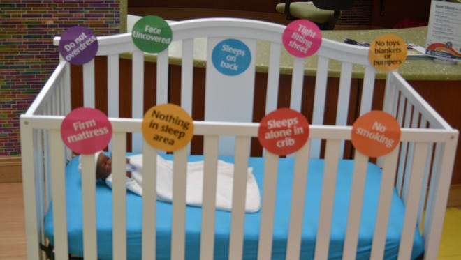 A display at Rapides Women's and Children's Hospital shows new parents what a safe sleep environment looks like.