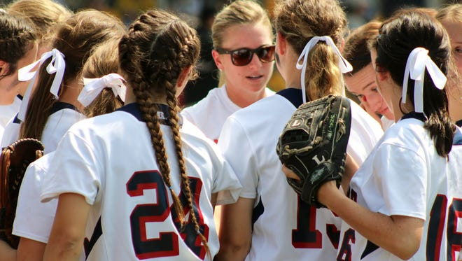 Notre Dame coach Ashley Ray tries to rally the troops during the Lady Pios 3-2 loss in the Class 2A semifinals to Calvary Baptist