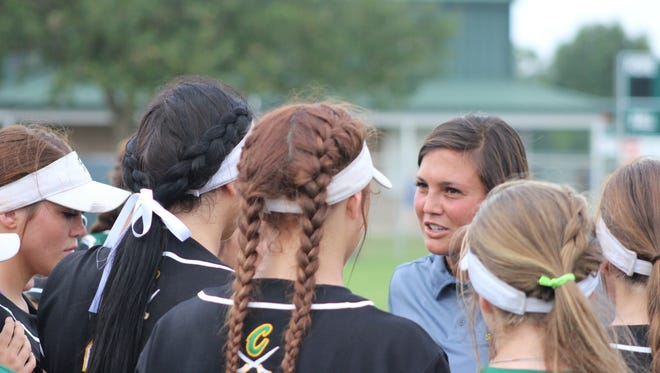 Calvary's Tiffany Frazier talks to team at Frasch Park.