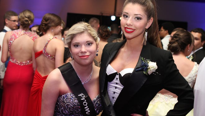Peyton Smith, left, and her sister Presley attended prom together on May 14 at Valor Hall in Oak Grove, Ky. Peyton, who has Chromosome 18Q-, was named prom queen.