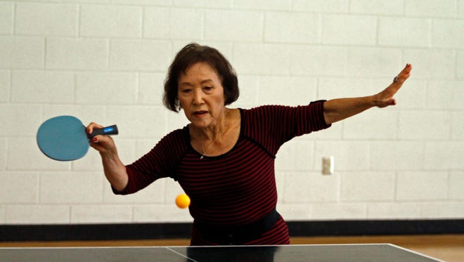 Yoshika Schooley is focused as she competes in ping pong at APSU's Foy Center. Schooley was one of 77 athletes at this year's 50+ Olympics.