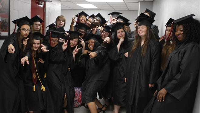 About 75 Middle College Class of 2016 students graduated at a ceremony in Austin Peay State University's Dunn Center on Thursday. They were enjoyed one another's company moments before the ceremony began.