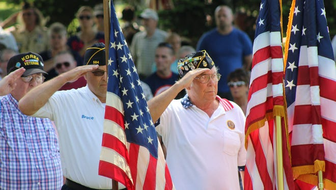 Marion County veterans salute as they post the colors during the Memorial Day ceremony Monday at Marion Cemetery. Veterans from various organizations participated in the parade and ceremony.