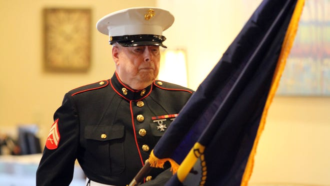 Chaplain, Jim Thompson presented the Navy flag as members of the Marine Corps League, Detachment 603 retired five flags representing the U.S. armed forces at a Flag Day ceremony at the Tennessee State Veterans' Home in Clarksville Tuesday.