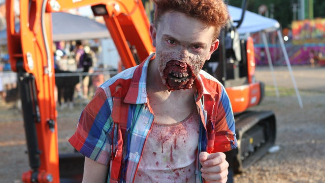 Clarksville Zombie Hunters are doing their best to contain the problem, but a few zombies were spotted roaming around the Fair on Friday.
