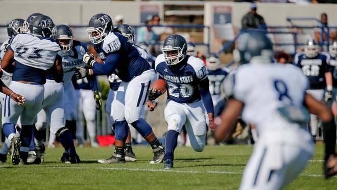 Robert Johnson IV (20) and the rest of the Jackson State football team will open fall camp on Aug. 2.