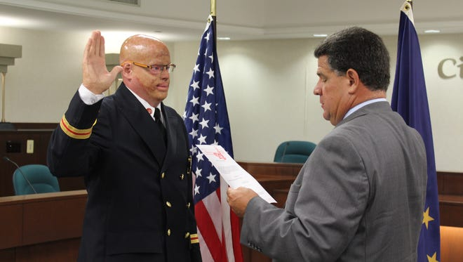 Brian Alkire is sworn in Monday as an assistant chief for Lafayette Fire Department.