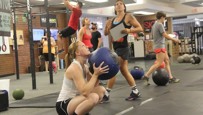 Athletes competing in the Summer Smackdown at CrossFit Staunton Saturday, Aug. 20, 2016.