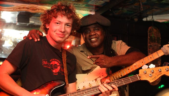 Daniel Walker at last year's Danny Walker Benefit Concert and Food Drive with legendary guitarist, Regi Wooten. The 2016 drive will benefit Manna Cafe Ministries, and happens this Saturday.