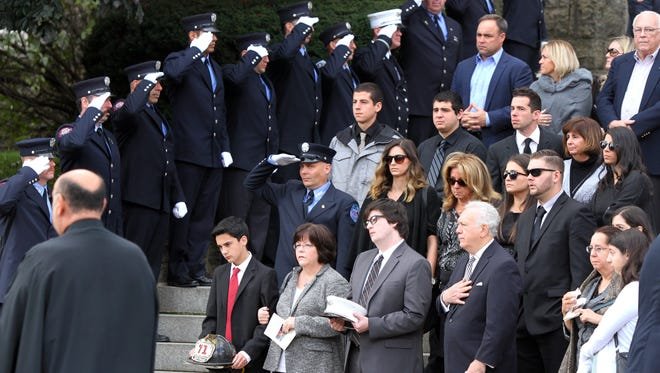 Family members of Lt. John Rodriquez of the Yonkers Fire Department during his funeral at St. John the Baptist Church in Yonkers on Oct. 24, 2016. Rodrigues died Tuesday from 9/11 related cancer.