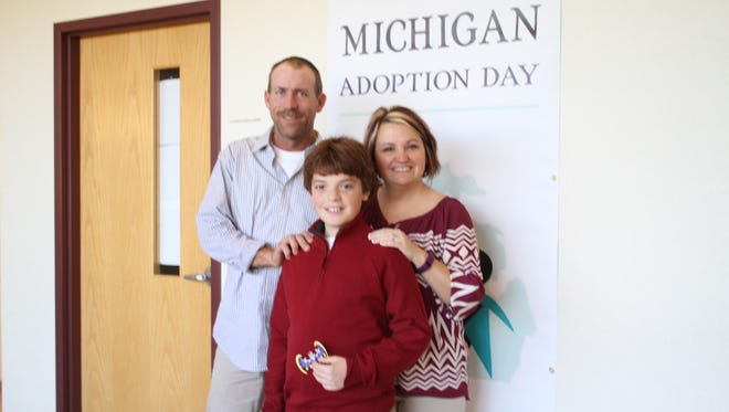 Tim Derry adopted Connor Wells on Tuesday, Nov. 22, 2016 which is Michigan Adoption Day. Also pictured is Connor's biological mom, Rachel Derry.