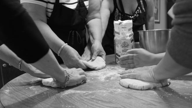 Women attending a baking class led by pastry chef Angela Ranalli-Cicala of South Philly knead cookie dough for authentic Italian cookies. Ranalli-Cicala grew up in this Marlton home now owned by Theresa Selover.