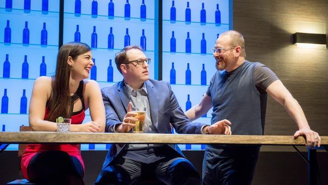 """Sarah Hoch, left, and Michael Gerard Carr, center, the stars of """"First Date,"""" take a break from rehearsal to talk with director Vince DeGeorge. The regional premiere of the 2012 musical runs at Ensemble Theatre Cincinnati Jan 18-Feb. 5, with a premier performance on Jan. 17."""