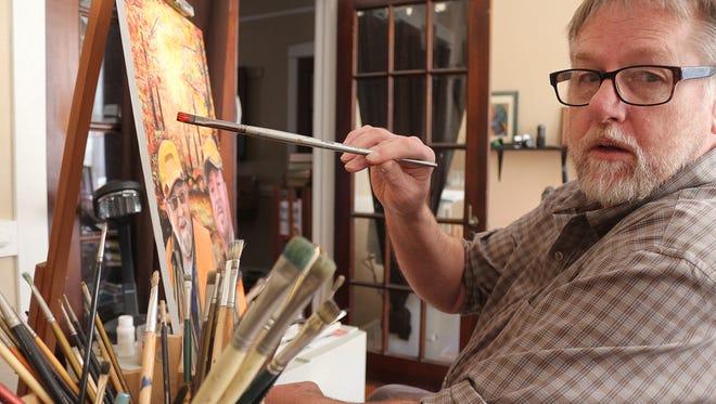 Religious artist Art Slatten at work in his studio on a commission portrait of pastors.