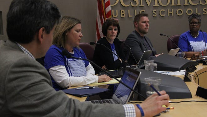 Des Moines school board members and the superintendent in February discuss plans to bar school staff from asking about a student's immigration status and funneling federal inquiries through the superintendent's office and district attorney.