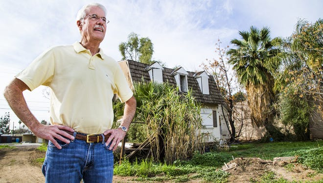 PHX Renews gardeners are planning a new garden at 1822 W. Pierson St., where two abandoned homes will be torn down for the space. Groups are moving from the garden at Indian School Road and Central Avenue in Phoenix. Tom Waldeck with Keep Phoenix Beautiful stands in the front yard of one of the houses that will be torn down.