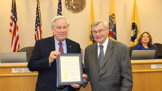 Somerset County Freeholder Director Peter Palmer (right) presented SCLSNJ County Library Administrator Brian Auger with a proclamation declaring March 11, 2017 Scripps Spelling Bee Day in Somerset County.