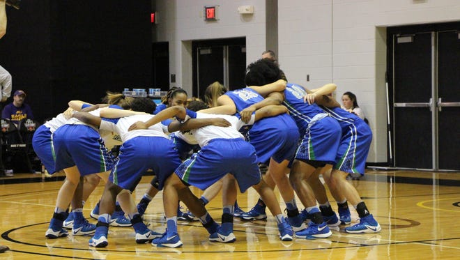 UWF players gather in pregame ritual before start of Tuesday's NCAA Elite Eight game in Columbus, Ohio.