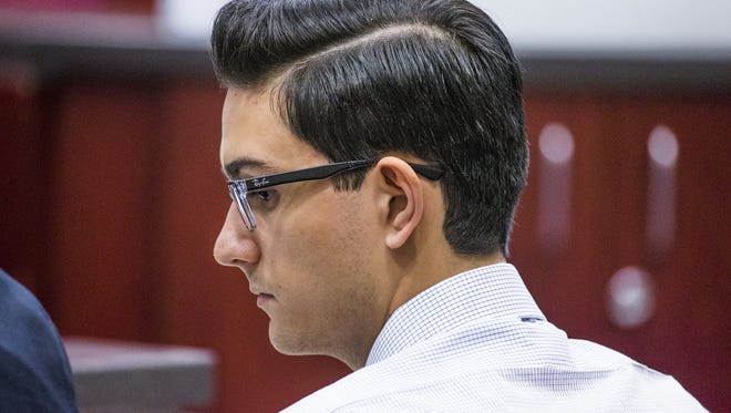 Steven Jones, the former Northern Arizona University student accused of killing one student and injuring three others during an incident in Flagstaff in 2015, listens to opening arguments in his murder trial in Coconino County Superior Court, Wednesday, April 5, 2017.