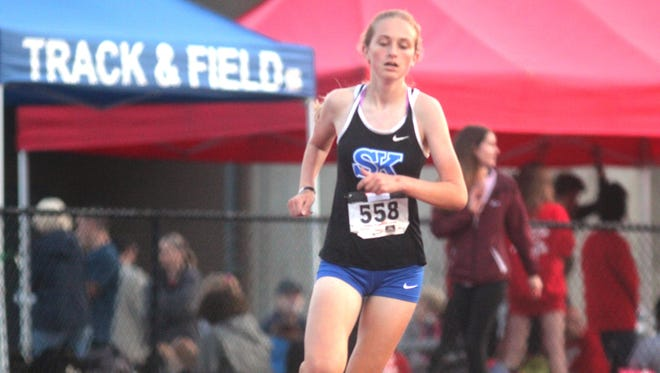Simon Kenton sophomore Sophia DeLisio wins the 3200 during the Class 3A, Region 5 track and field championships May 12, 2017 at Dixie Heights.