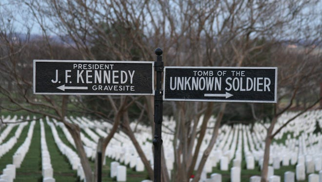 A sign post from Arlington to the grave site of John F. Kennedy and the Tomb of the Unknown Soldier