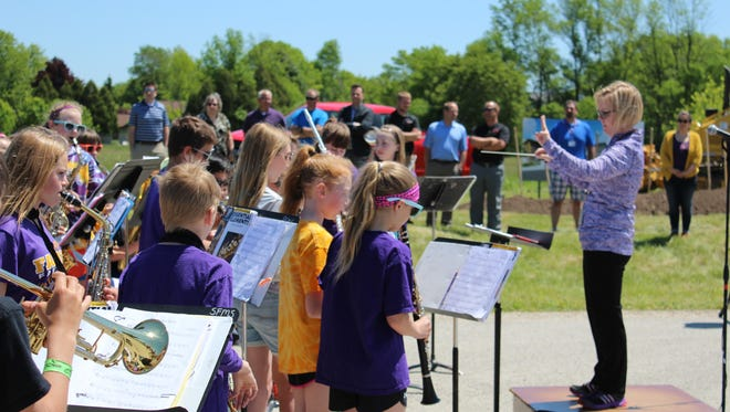 Sheboygan Falls School District's sixth-grade band plays at the groundbreaking of the new middle school.