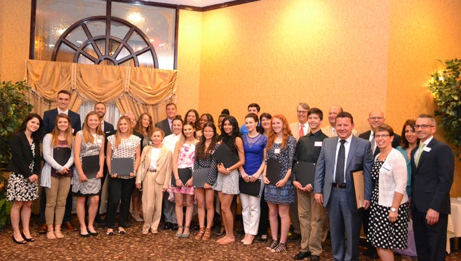 The 2017 recipients and presenters of the Chamber Foundation scholarships are shown during the June 21 event.