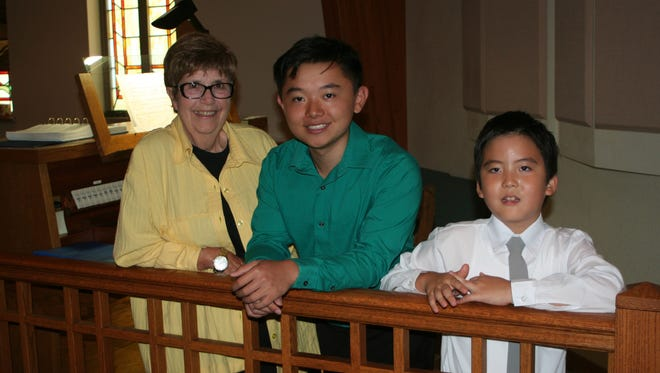 Fond du Lac Area Organists Association Scholarship recipients Jason Wang (center) and Jake Kim (right) appeared with their teacher Georgene Antos in a recital at First Presbyterian Church Aug. 3.