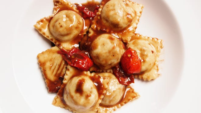 Short rib ravioli, made with beef braised in Malbec and served with blistered tomatoes, is a dish made by Big Mouth Pasta of Madison. The company, which makes Argentine-style pasta, is having a pop-up dinner Sept. 3 at Amilinda in downtown Milwaukee.