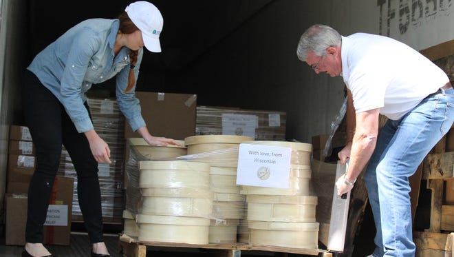 Cheese is packed and prepared to be shipped to Houston to aid in the Hurricane Harvey relief efforts.