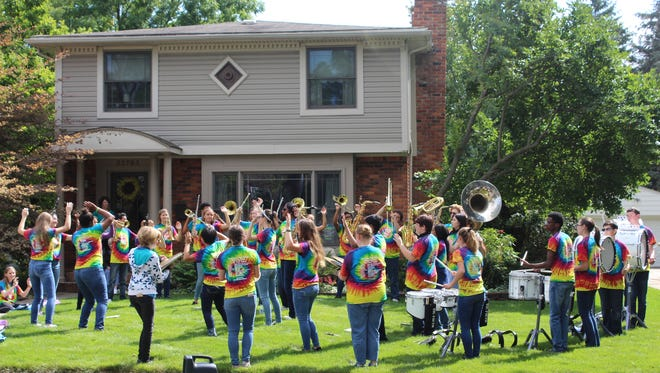 "The Farmington Marching Band performed at various locations as part of its ""Band on Your Lawn"" fundraiser."