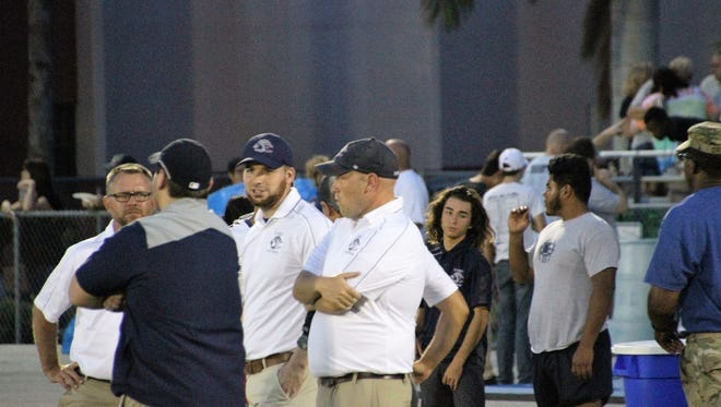 Estero High football coach Brad Vojcak (second from right) gathers with his assistants during an Oct. 6, 2017 game against Lemon Bay. Vojcak, who was elevated from interim coach to permanent head coach in February, resigned Tuesday due to a family situation out of state.
