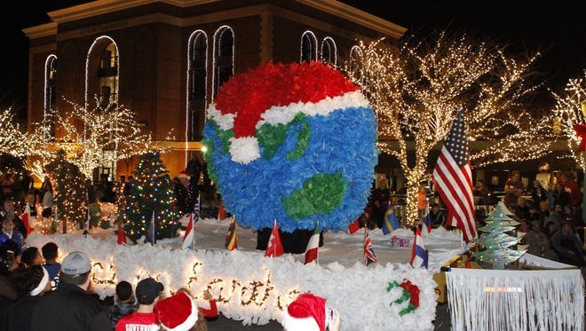 More than 125 entries in this year's Clarksville Christmas Parade brought thousands of spectators to downtown streets Saturday.