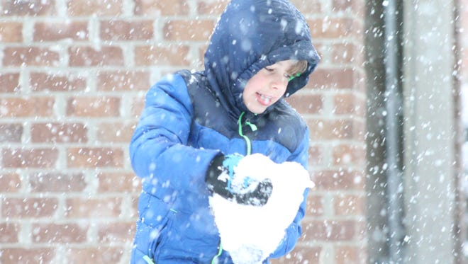 Oliver Duncan, 6, plays in the snow Friday morning in Hattiesburg.