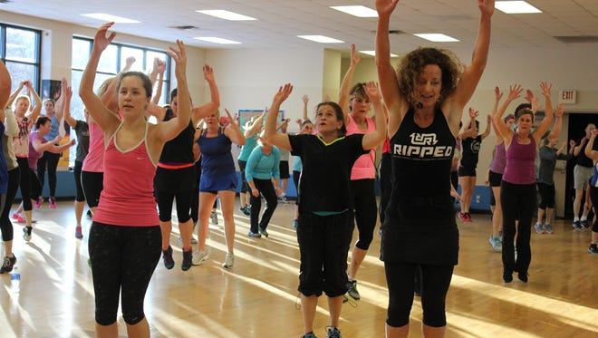 YMCA instructor Laura Lawler, right, will lead the RIPPED workout as part of the Woodson YMCA's Santa Jam on Dec. 23.