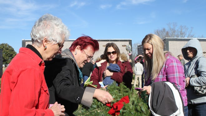 Hundreds participated in the annual Wreaths Across America ceremony at Resthaven Memorial Gardens Saturday.