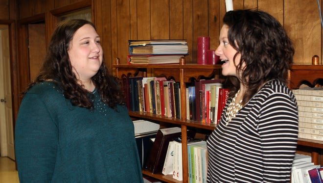 Judith Long, left, discusses upcoming Wesley Foundation events with the Rev. Katie Woodard, right.