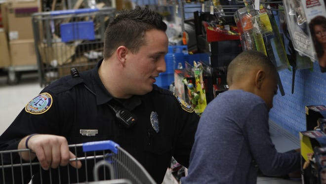 Springfield Police Department officers participated in the annual Shop With A Cop at Walmart Friday morning.