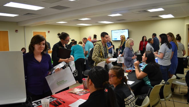 Job seekers meet with employers at a previous Kenton County Public Library job fair. One of the area's biggest job fairs will be at the Erlanger Branch library Jan. 18.