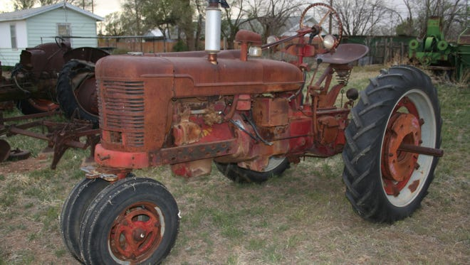 Between 3 and 4 p.m., on or about Dec. 20, 2017, three people went into a field, on the southeast corner of Depot Road and State Road 34 in the town of Knowlton, and stole a red Farmall H tractor.